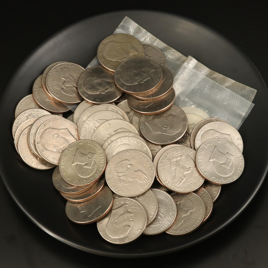 Fifty-Six Eisenhower Dollars, Including Two Uncirculated Silver Dollars