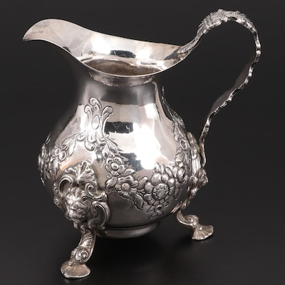 American Rococo Style Repoussé Sterling Silver Creamer with Lion Head Feet