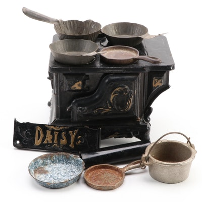 Daisy Cast Iron Child's Toy Stove with Pots and Pans, circa 1900