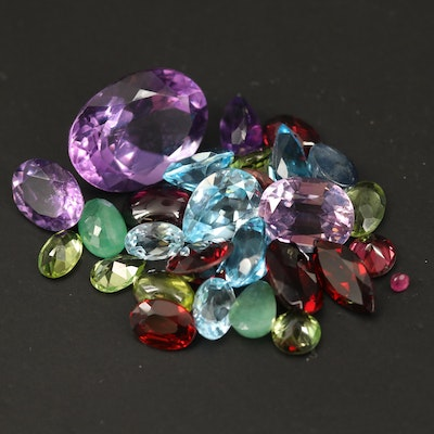 Loose 38.78 CTW Gemstones Including Amethyst, Peridot and Sapphire