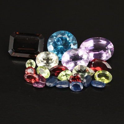 Loose 33.43 CTW Gemstones Including Sapphire, Garnet and  Peridot