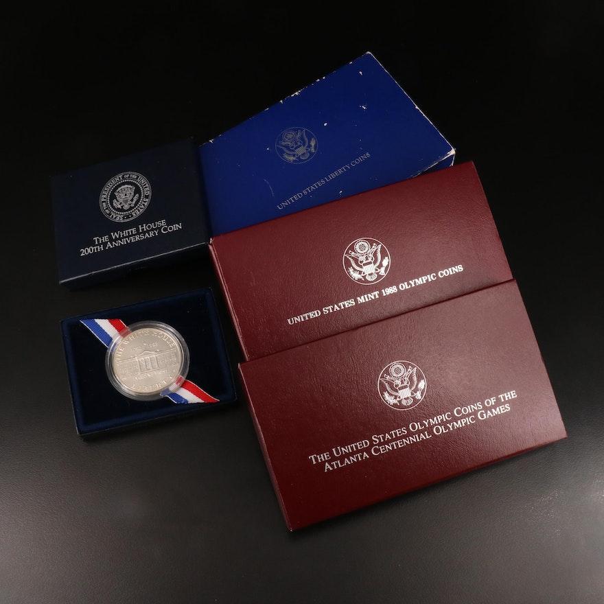 Four Modern Commemorative Silver Dollars