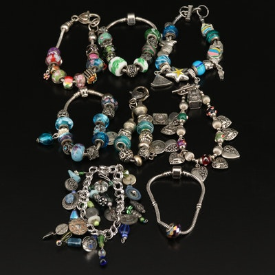 Charm Bracelets Including Sterling Silver, Enamel and Art Glass
