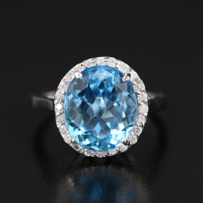 14K 6.10 CT Blue Topaz and Diamond Halo Ring