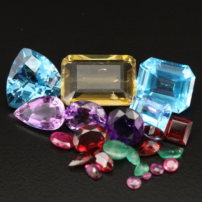 Loose 57.32 CTW Faceted Gemstones Including Topaz, Amethyst and Ruby