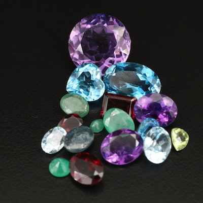Loose 40.06 CTW Gemstones Including Amethyst, Emerald and Topaz