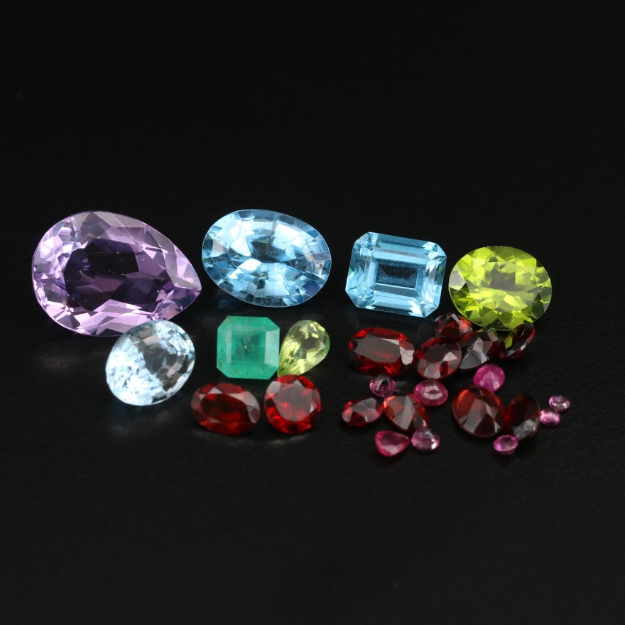 Loose 39.73 CTW Gemstones Including Amethyst, Topaz and Garnet