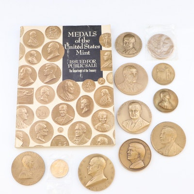 Eleven Commemorative Bronze Medals and U.S. Mint Medals Reference Book