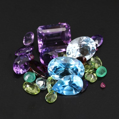 Loose 38.69 CT Faceted Gemstones Featuring Amethyst, Peridot and Rubies