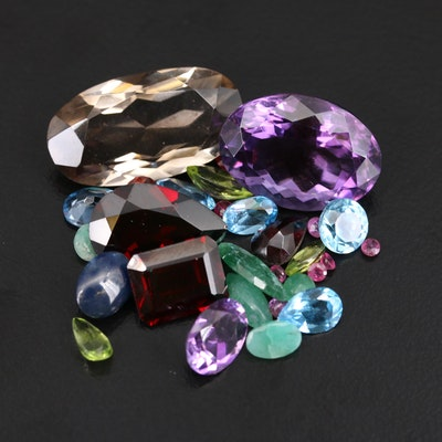 Loose 46.93 CTW Gemstones Including Garnets and Rubies