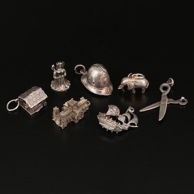 Vintage Sterling Charm Selection Featuring Various Designs
