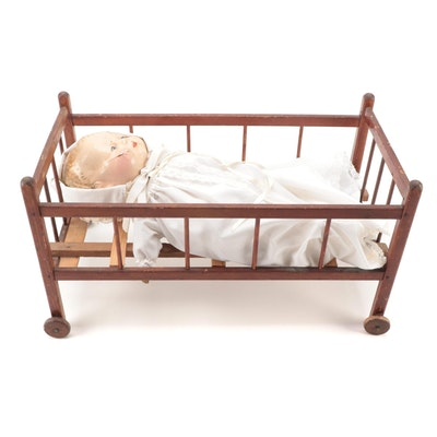 Composition Baby Doll with Painted Eyes and Cloth Body in Wooden Doll Crib