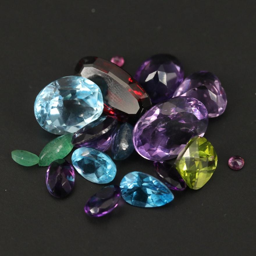 Loose 33.81 CTW Mixed Gemstones Including Amethyst, Garnet and Swiss Blue Topaz