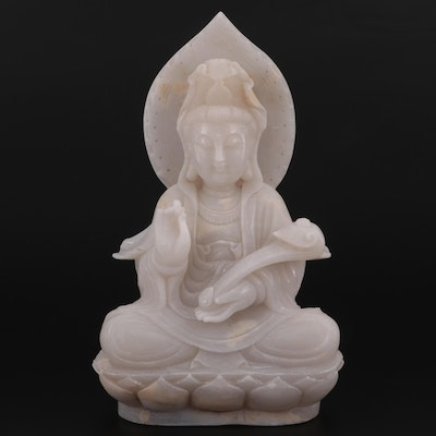 Chinese Carved Quartzite Figure of Guan Yin Seated on a Lotus Throne