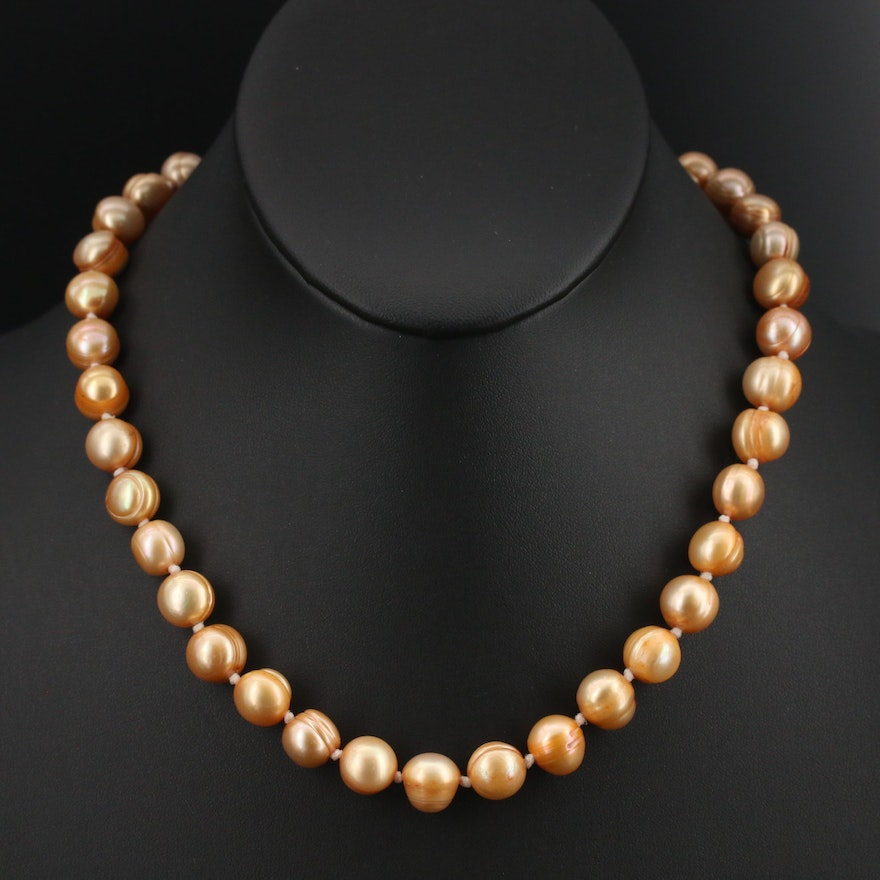 Strand of Circle Pearls with 14K Clasp