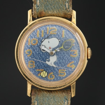 Vintage Snoopy Tennis Gold Tone Stem Wind Wristwatch