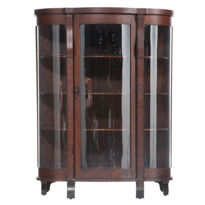 American Empire Revival Oak Curved Glass Bowfront Display Cabinet, Early 20th C.