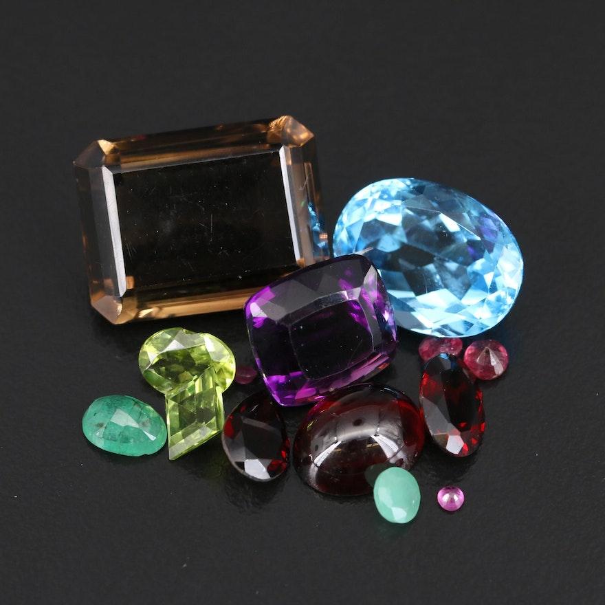 Loose 56.15 CTW Gemstone Selection Featuring Smoky Quartz, Topaz and Garnet
