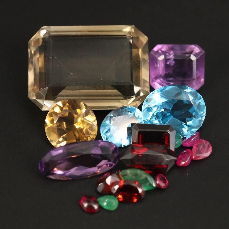 Loose 50.73 CTW Gemstones Including Smoky Quartz, Swiss Blue Topaz and Amethyst