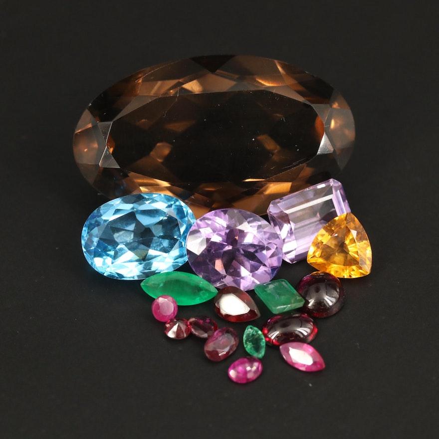 Loose 74.18 CTW Gemstones Including Smoky Quartz, Swiss Blue Topaz and Amethyst
