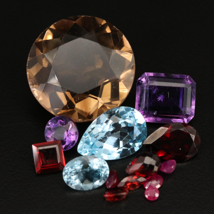 Loose 55.90 CTW Swiss Blue Topaz, Garnet and Additional Gemstones
