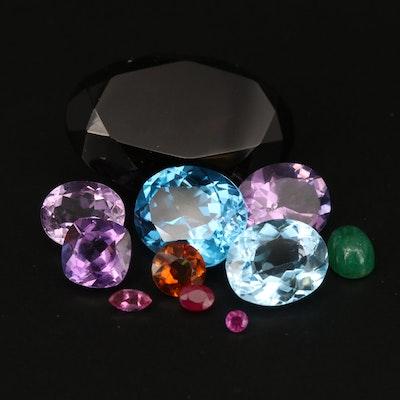 Loose 63.55 CTW Smoky Quartz, Swiss Blue Topaz, Amethyst and Additional Gems
