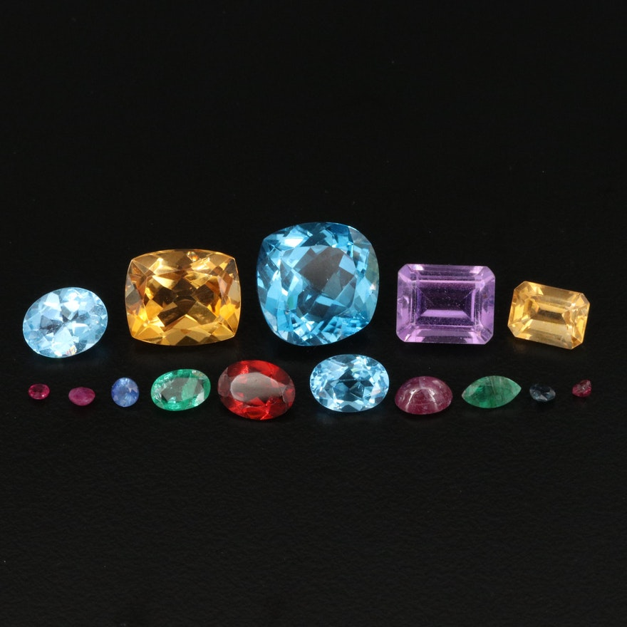Loose 27.13 CTW Mixed Gemstones Including Ruby, Sapphire, Emerald and Topaz