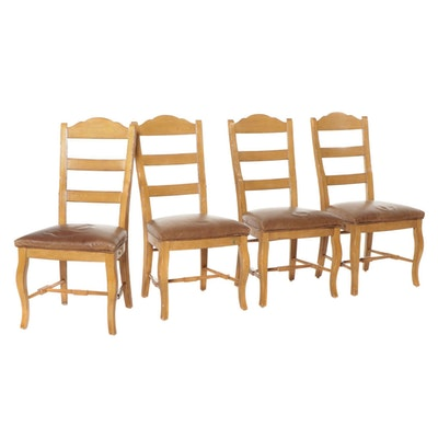 Four Leather Upholstered Blonde Wood Ladderback Dining Chairs