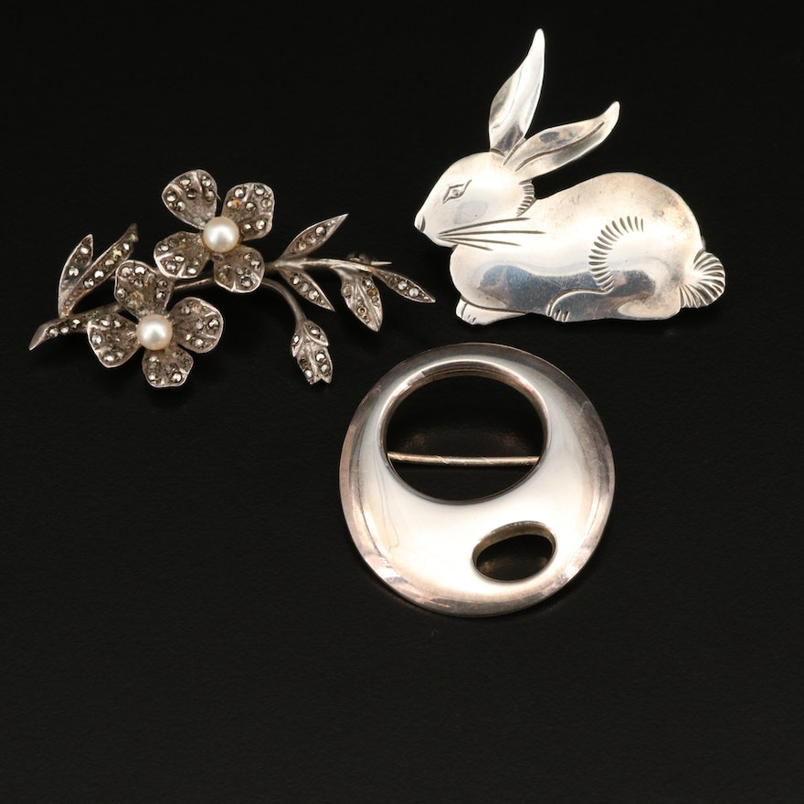 Sterling and 835 Brooches Including Pearl and Marcasite