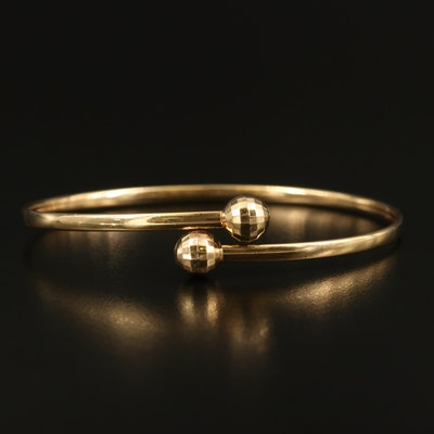 14K Bypass Bracelet with Faceted Sphere Ends