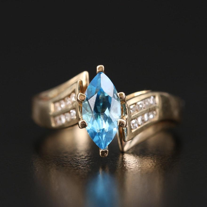 10K Swiss Blue Topaz and Diamond Bypass Ring