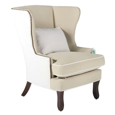 Klausser Upholstered Wing Back Armchair with Nail Tack Detailing