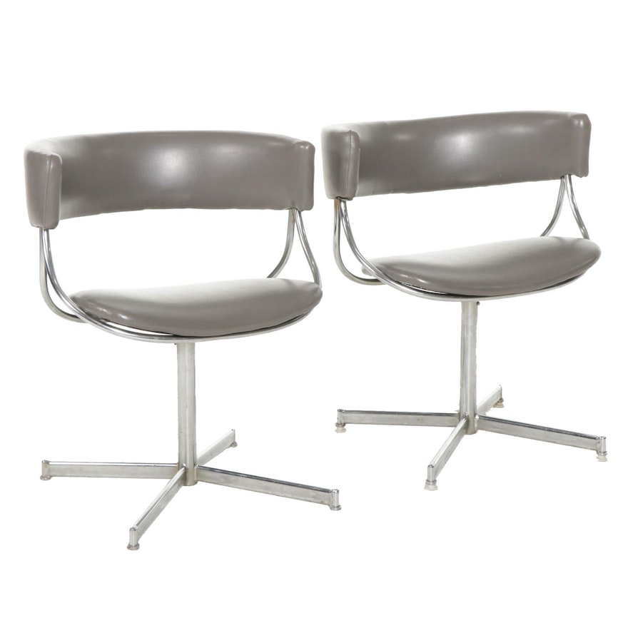 Pair of Mid Century Modern Chrome and Faux Leather Swivel Chairs