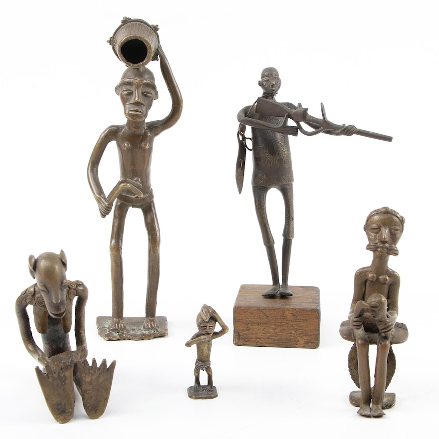 West African Brass Figures Including a Hunter with Rifle