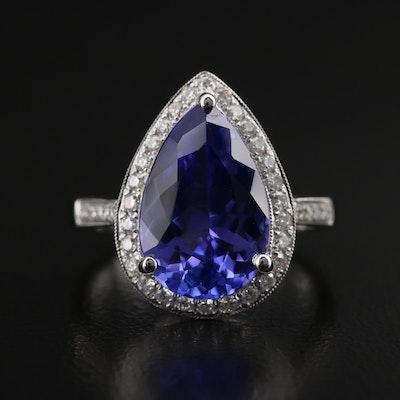 18K 4.56 CT Tanzanite and Diamond Halo Ring