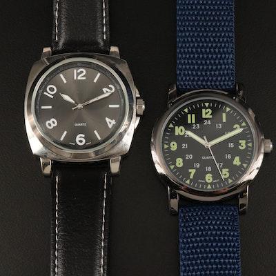A Pair of White and Black Tone Quartz Wristwatches