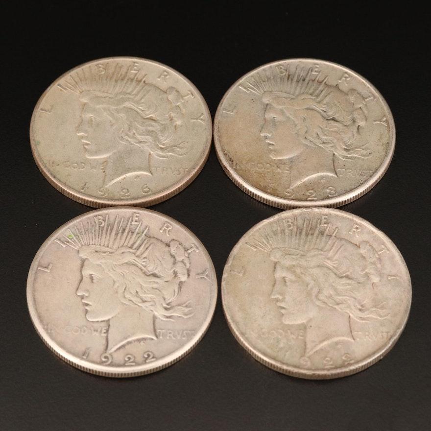 Four Peace Silver Dollars