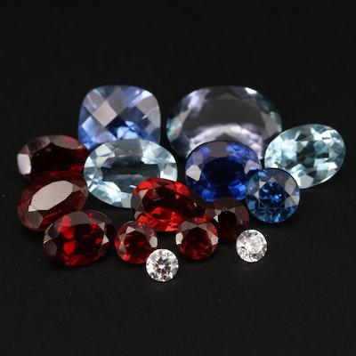 Loose Gemstones with Tanzanite, Garnet and Laboratory Grown Sapphire