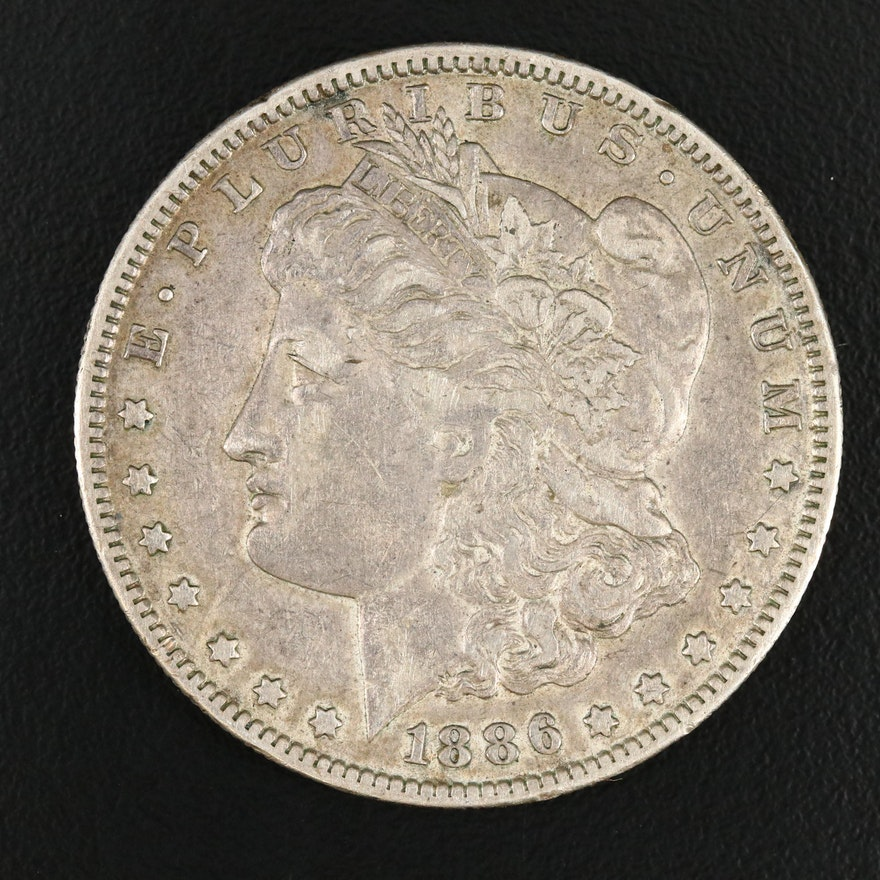 Toned 1886-O Morgan Silver Dollar