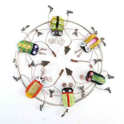 """PDC Maria Fused Glass and Metal Sculpture """"Bugs' Pizza and Hotdog Party,"""" 2010"""