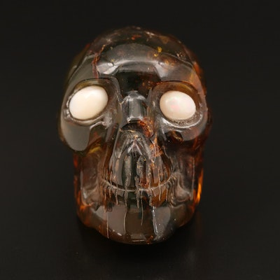 Carved Amber Skull with Opal Eyes