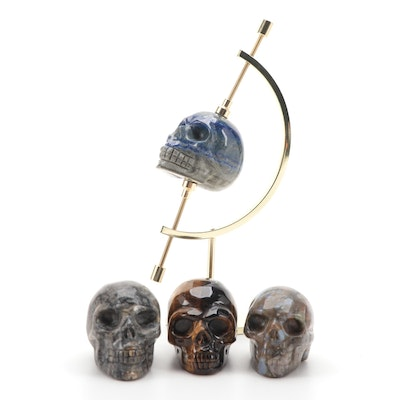 Sodalite, Tiger's Eye and Other Carved Stone Skulls with Caliper Stand