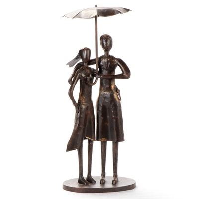 Cast Metal Sculpture of a Couple Standing Under Umbrella