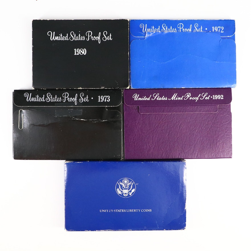 Four Proof Sets and a Statue of Liberty Commemorative Coin Set