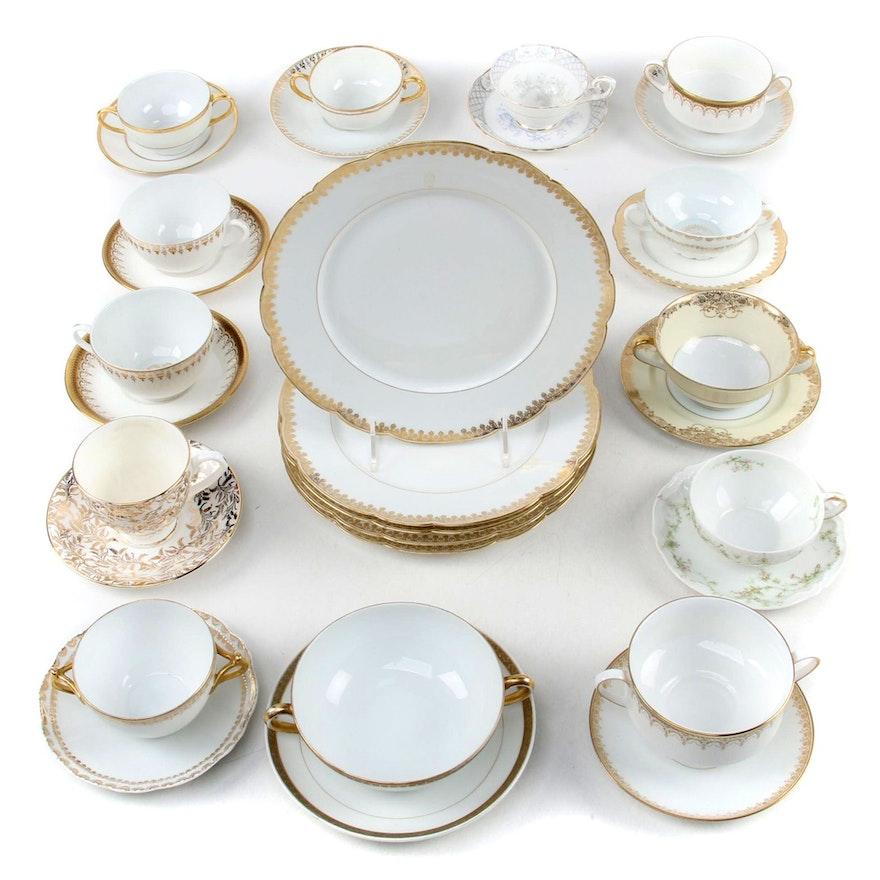 Tressemann & Vogt Plates with Assorted Gilt and White Porcelain Serveware