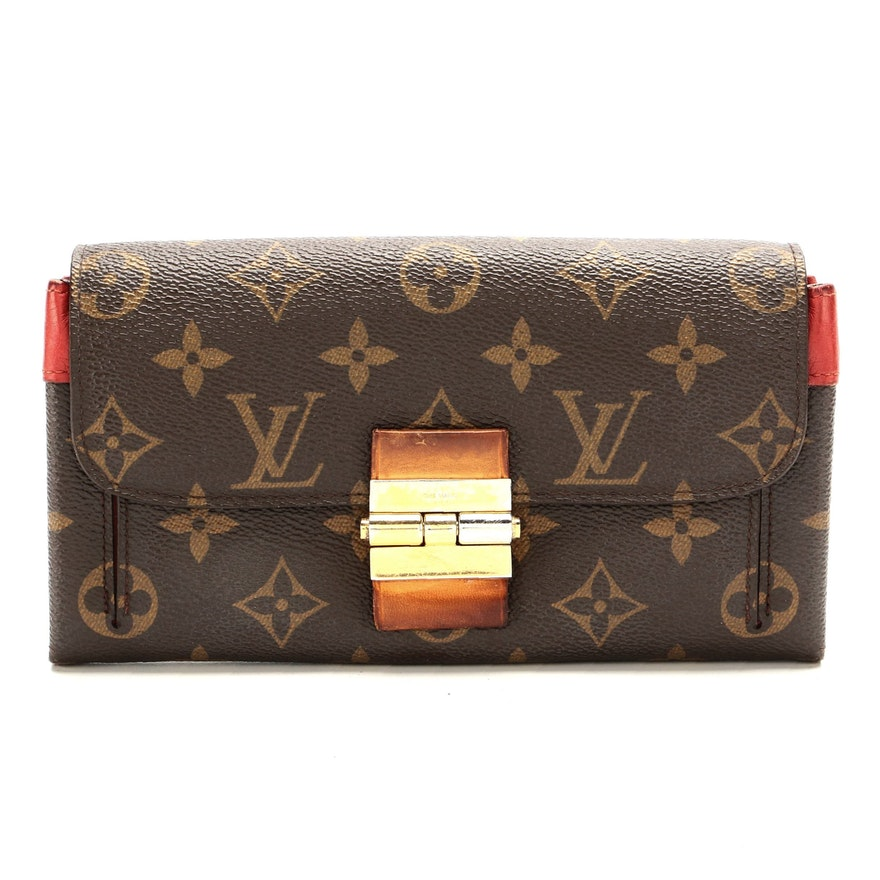 Louis Vuitton Elysee Wallet in Monogram Canvas and Red Orient Leather