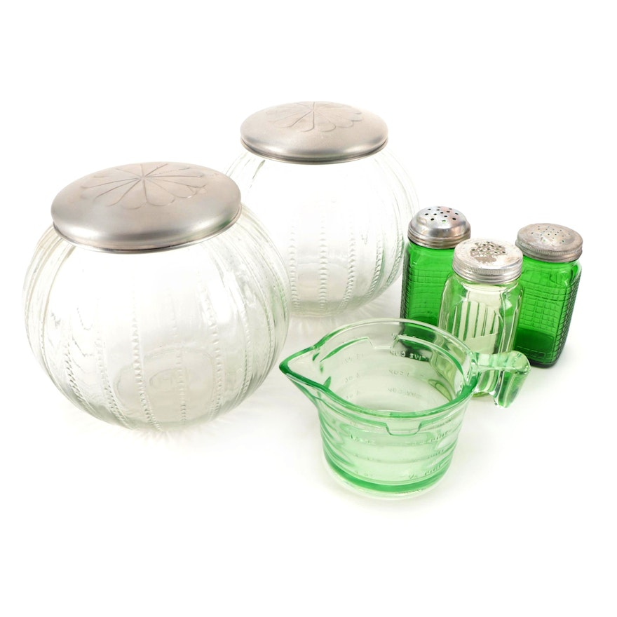 Vaseline and Green Glass Measuring Cup and Shakers with Tin Lidded Candy Jars