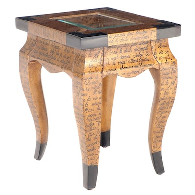 Louis XV Style Gilt-Decorated, Parcel-Ebonized, and Glass Top Side Table