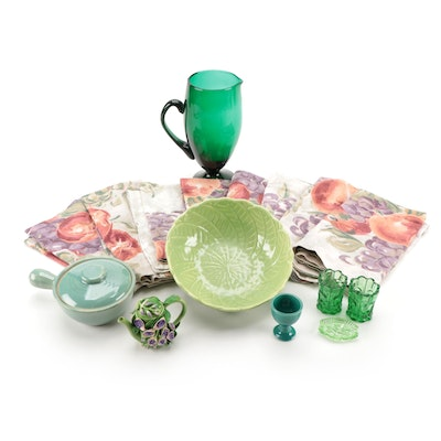 Cemar Leaf Bowl with Green Glass and Ceramic Vessels, and Linen Tableware