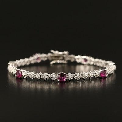 Sterling Topaz Line Bracelet with Rhodolite Garnet Accents